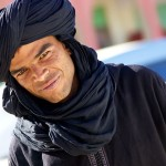 Arab man dressed in black with black turban