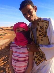 Preparing for a camel ride in Chegga, Morocco