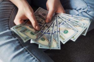 hand full of USD